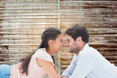 Composite image of attractive young couple smiling at each other Stock Photos
