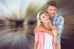 Composite image of attractive young couple smiling together Stock Images