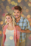Composite image of attractive young couple smiling together Royalty Free Stock Photos