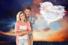 Composite image of attractive young couple smiling together Stock Photo