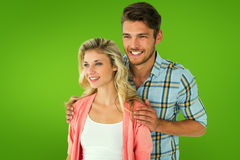 Composite image of attractive young couple smiling together Royalty Free Stock Photo