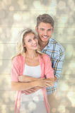 Composite image of attractive young couple smiling together Royalty Free Stock Images