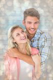 Composite image of attractive young couple smiling together Royalty Free Stock Photography