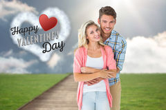 Composite image of attractive young couple smiling together Royalty Free Stock Image