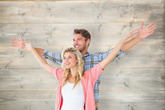 Composite image of attractive young couple standing with hands out Royalty Free Stock Photos