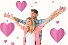 Composite image of attractive young couple standing with hands out. Attractive young couple standing with hands out against hearts royalty free stock image