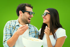 Composite image of attractive young couple watching a 3d movie Stock Image