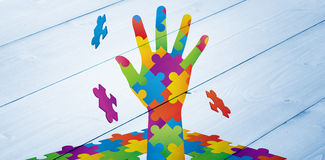 Composite image of autism awareness hand Stock Photos