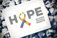 Composite image of autism awareness month. Autism awareness month against tablet pc royalty free stock photo