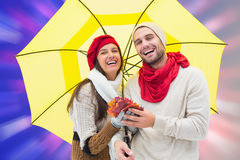 Composite image of autumn couple holding umbrella Royalty Free Stock Photography