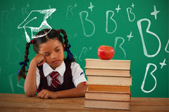 Composite image of b plus doodle. B plus doodle against unhappy schoolgirl looking at books stack and apple against chalkboard Stock Image