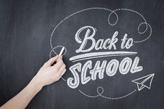 Composite image of back to school. Back to school against hand writing with chalk on board Stock Photography