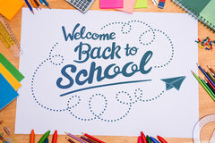 Composite image of back to school. Back to school against students desk Royalty Free Stock Photos