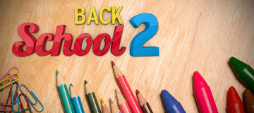 Composite image of back to school. Back to school against students desk Stock Photo