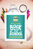 Composite image of back to school. Back to school against students desk with tablet pc Stock Images