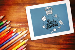 Composite image of back to school. Back to school against students desk with tablet pc Stock Photo