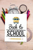 Composite image of back to school. Back to school against students desk with white page Royalty Free Stock Images
