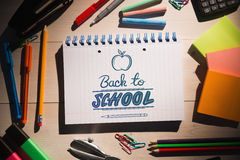 Composite image of back to school. Back to school against students table with school supplies Stock Photos