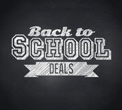 Composite image of back to school deals message. Composite image of  Back to school deals message against blackboard Royalty Free Stock Photo