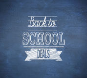 Composite image of back to school deals message. Against blue chalkboard Stock Images