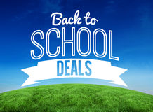 Composite image of back to school deals message. Back to school deals message against green hill under blue sky Royalty Free Stock Photo