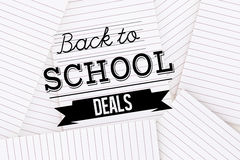 Composite image of back to school deals message. Back to school deals message against lined paper strewn over surface Royalty Free Stock Image