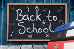 Composite image of back to school message. Back to school message against blackboard with copy space on wooden board Stock Images