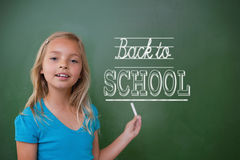 Composite image of back to school message. Against cute pupil holding chalk Stock Photo