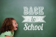 Composite image of back to school message. Against cute pupil shouting Stock Photo