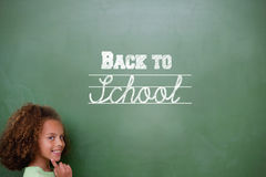 Composite image of back to school message. Against cute pupil thinking Stock Images