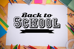 Composite image of back to school message. Back to school message against students desk Royalty Free Stock Photo
