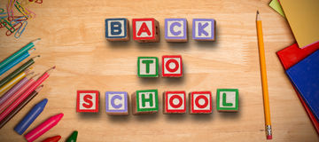 Composite image of back to school message. Back to school message against students desk Royalty Free Stock Photography