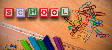 Composite image of back to school message. Back to school message against students desk Royalty Free Stock Photos