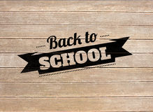 Composite image of back to school message. Back to school message against wooden surface with planks Stock Photo