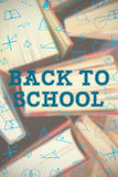 Composite image of back to school message. Back to school message against close-up of books arranged Royalty Free Stock Image