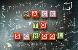 Composite image of back to school message. Back to school message against empty blackboard in school royalty free illustration