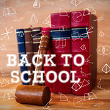 Composite image of back to school message. Back to school message against gavel with books Royalty Free Stock Image
