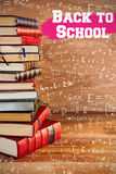 Composite image of back to school message. Back to school message against stack of books Royalty Free Stock Image