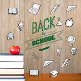 Composite image of back to school message with icons. Back to school message with icons against red apple on pile of books Stock Image