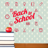 Composite image of back to school message with icons. Back to school message with icons against red apple on pile of books Stock Photo