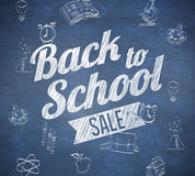 Composite image of back to school sale message. Against blue chalkboard Stock Photo
