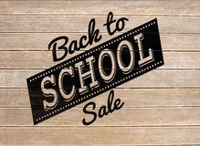 Composite image of back to school sale message. Back to school sale message against wooden surface with planks Stock Photos