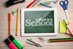 Composite image of back to school text against white background. Back to school text against white background against cloudy sky Stock Images