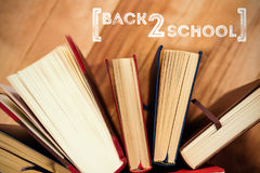 Composite image of back to school text over white background Stock Photos