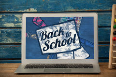 Composite image of back to school text on paper with pen Stock Photography