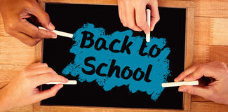 Composite image of back to school text on pink splash Royalty Free Stock Images