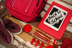 Composite image of back to school text on pink splash Stock Photo