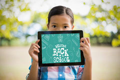 Composite image of back to school written on chalkboard Stock Image