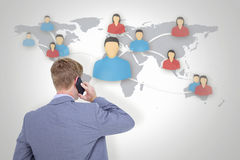 Composite image of back turned businessman on the phone Royalty Free Stock Photo