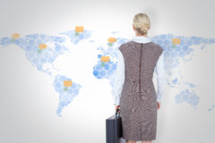 Composite image of back turned businesswoman holding a briefcase Stock Photos